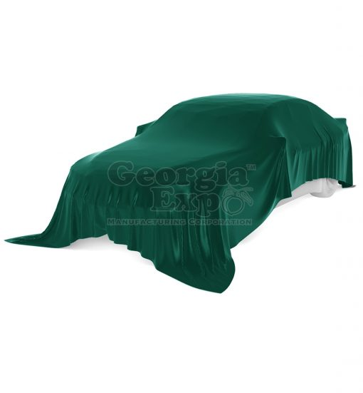 car with green unveiling cloth