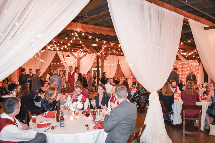 white sheer pipe and drape wedding