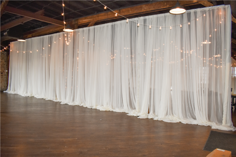 sheer pipe and drape wall at wedding
