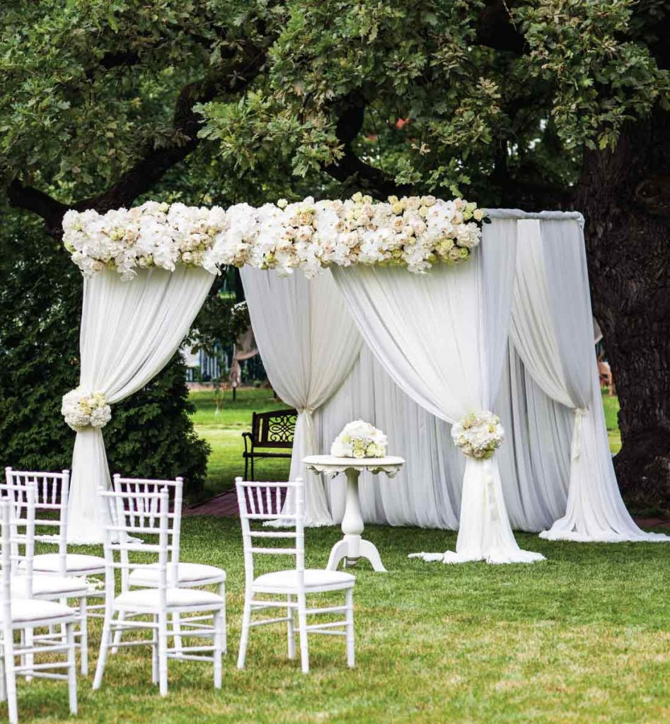 wedding canopy white sheer styled peonies