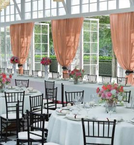 sheer drape coral wedding set up