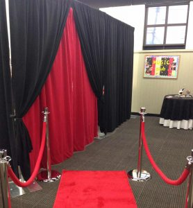 velour backdrop black and red plus red carpet and stanchions