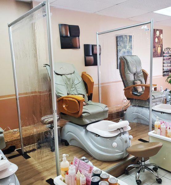 social distancing wall in a nail salon