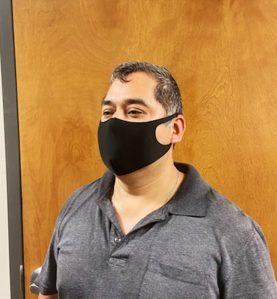 black sleek mask in use man